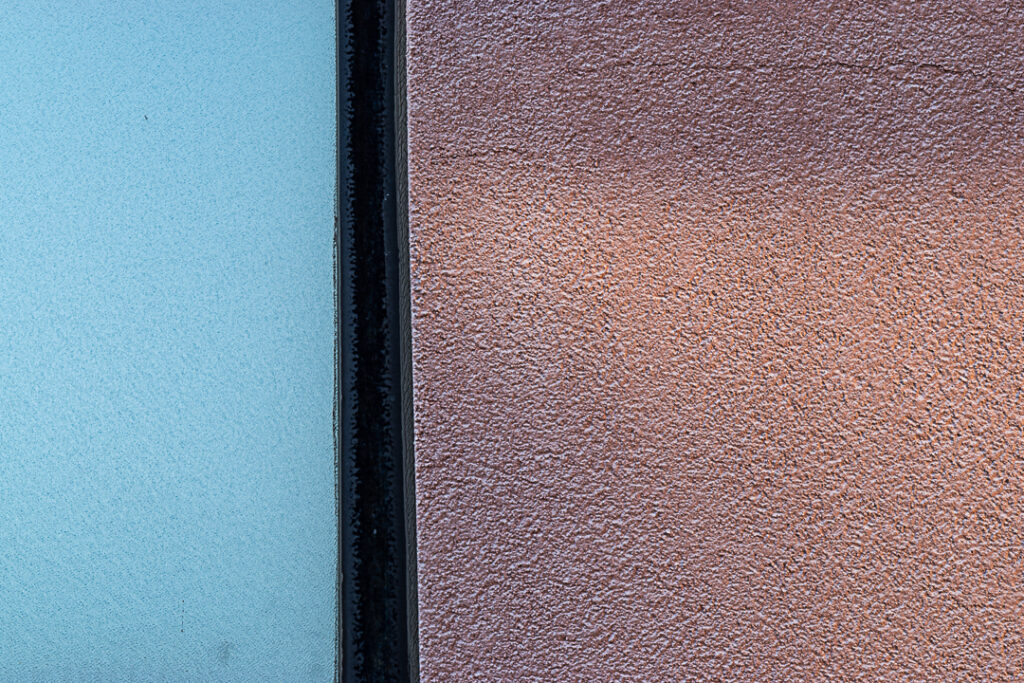 Minimalist photo of pink textured wall and frosted window