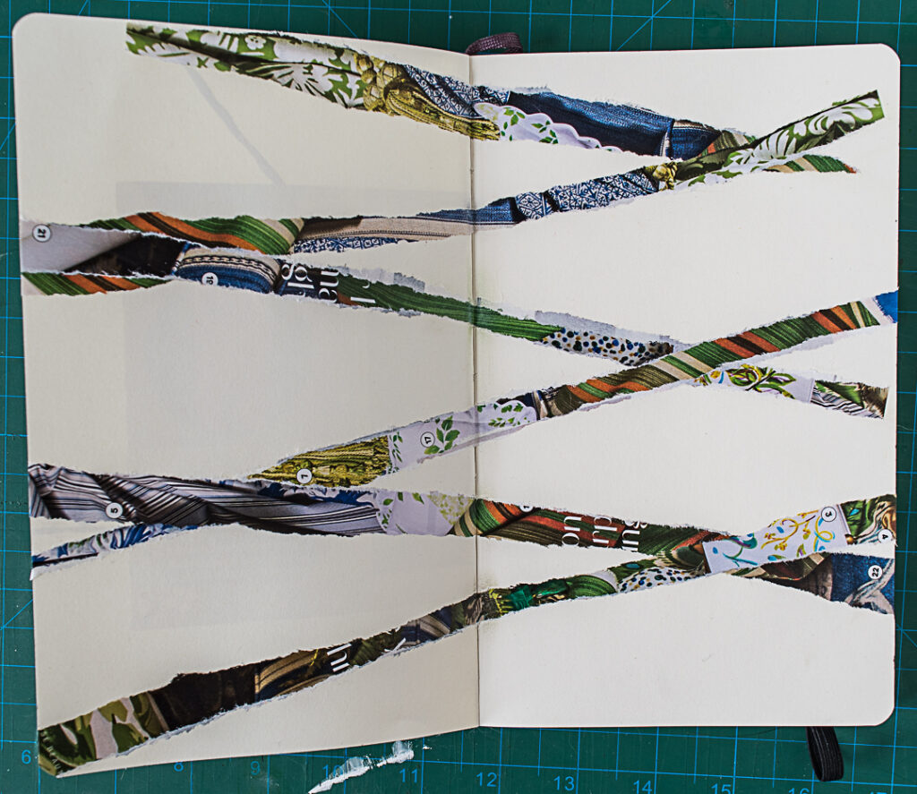Torn paper strips glued into art journal