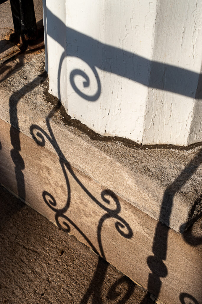 Railing shadow on steps and column