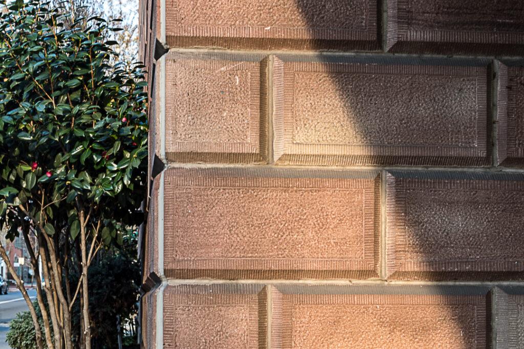 Diagonal shadow on a stone wall