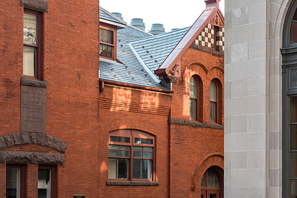 Patches of sunshine on brick market building.