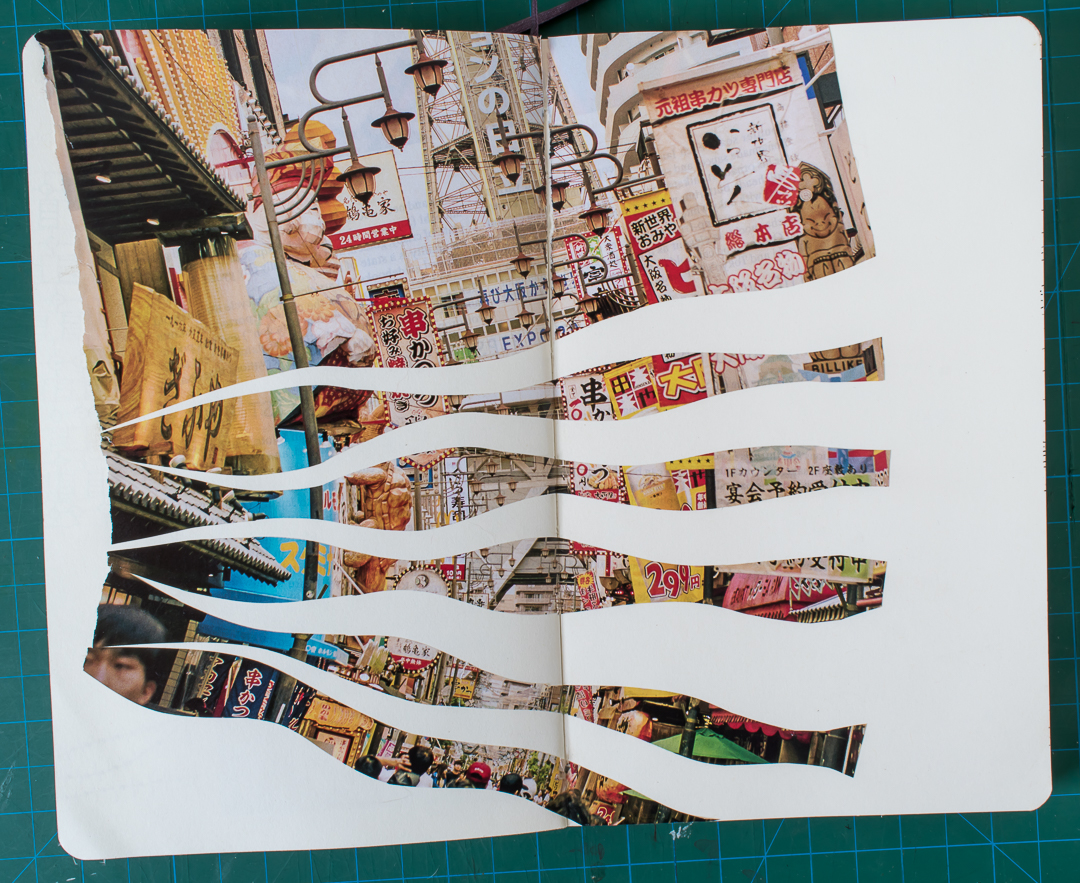 Gluing the photo and the strips onto the spread