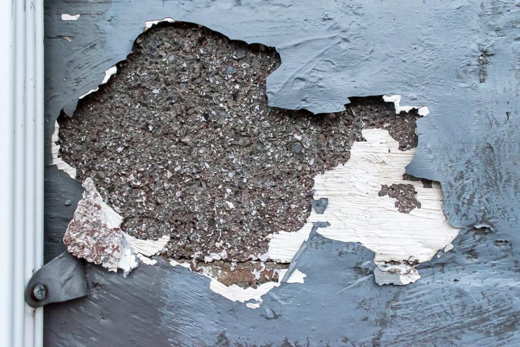 Peeling gray paint